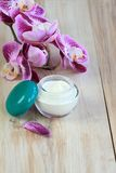 Face and body cream with orchid Royalty Free Stock Photography