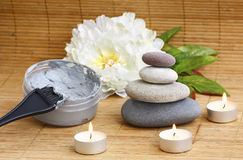 Face and body mask, pebbles, flower and burning ca Royalty Free Stock Photo