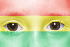 Face with bolivian flag. Human`s face with bolivian flag Royalty Free Stock Images