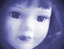 Face bonita da boneca no azul. imagem de stock royalty free