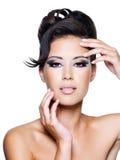 Face bonita de uma mulher nova do encanto Foto de Stock Royalty Free