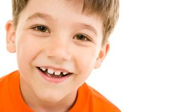 Face of boy. Face of smiling boy with brown eyes on a white background stock photo