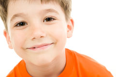 Face of boy. Face of smiling boy with brown eyes on a white background Royalty Free Stock Photography