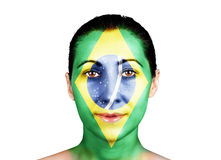 Face with the Brazil flag. Face of a woman with the Brazil flag royalty free stock photo