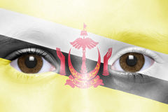 Face with brunei flag. Human`s face with brunei flag Stock Photos