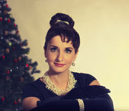 Face Brunette on the background of Christmas tree Royalty Free Stock Images