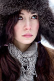 Face of brunette hair woman in fur hat Royalty Free Stock Images