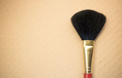 face brush on a cardboard background Royalty Free Stock Photo