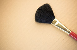face brush on a cardboard background Royalty Free Stock Photos