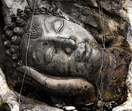 Face of budda statue. On grunge wall royalty free stock photo