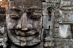 Face of Buddha. One of the anciet ruins in Siem Reap Stock Image