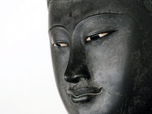 Face of Buddha. Face of a Buddha Statue Isolated on a White Background with Plenty of Copy Space Stock Photos