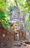 Face of Buddha in Angkor Thom entrance Royalty Free Stock Images