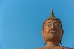 Face of Buddha on Blue background Stock Photos