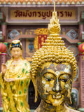 Face of Buddha. Front and the Goddess of Mercy blur background Royalty Free Stock Photos