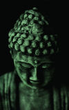 Face of Buddha in green Royalty Free Stock Photography
