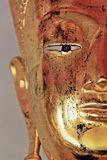 Face of Buddha image. Half gold color ear Norse eyes beautiful background Stock Image