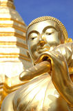 Face of buddha statue with golden pagoda Stock Photo
