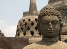 Face of buddha statue on the top of borobudur temple, yogyakarta. Indonesia Royalty Free Stock Image