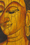 Face of buddha, Thai style painted on wood. Face of buddha, Thai style painted on old wood royalty free stock image