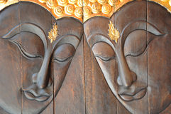 Face of a buddha wood handmade royalty free stock images