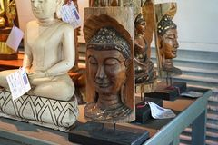 Face of a buddha wood handmade sale in the souvenier shop royalty free stock photos