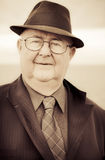 The Face Of Business From Yesteryear. Sepia Toned Close-up Face Portrait Of A Retro Senior Male In Business Attire Displaying An Expression Of Fascination Royalty Free Stock Photos