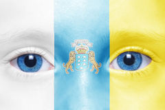 Face with canarian flag. Human`s face with canarian flag royalty free stock image