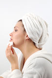 Face care #6. Attractive woman with towel on white background Stock Photography