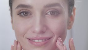 Face Care. Attractive Woman Touching Skin Under Eyes Closeup