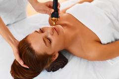 Face care. Ultrasound cavitation face treatment in medical spa c Royalty Free Stock Image