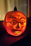 Face carved in pumpkin shines Stock Images