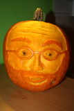 Face carved in pumpkin shines Royalty Free Stock Photo
