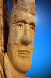 Face Carved on Tree Trunk. Close-up view of face carved on tree trunk - Trentino Italy Stock Photos