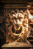 Face of a carved wooden lion Stock Photography