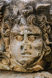 Face carving of the Medusa Stock Photos