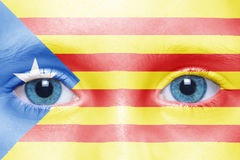Face with catalan flag. Child`s face with catalan flag Stock Photo