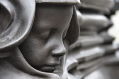Face of a Child. These faces surround the base of the statue of Queen Victoria outside St Nicholas' Church, Newcastle upon Tyne Royalty Free Stock Photography