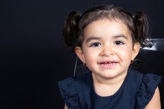 Face child girl portrait happy smile in black background royalty free stock image
