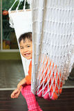 Face of children sitting in clothes cradle and smiling use for f Stock Photography