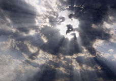 The face of Christ in the sky. Dramatic clouds with sunbeams formed the face of Jesus Christ Stock Photos