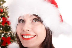 Face of christmas girl in santa hat. Royalty Free Stock Image