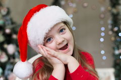 Face, Christmas hat, red suit Royalty Free Stock Photos