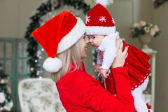 Face, Christmas hat, red suit Royalty Free Stock Photography