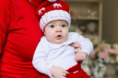 Face, Christmas hat, red suit, hands mother, fun Royalty Free Stock Images