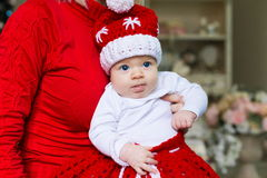 Face, Christmas hat, red suit, hands mother, fun Stock Image