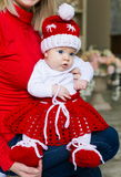 Face, Christmas hat, red suit, hands mother, fun Royalty Free Stock Image