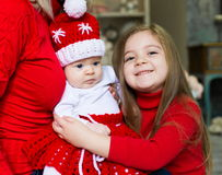Face, Christmas hat, red suit, hands mother, fun Royalty Free Stock Photos