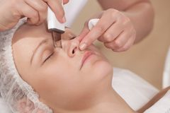 Face cleaning with ultrasonic equipment at beauty stock image