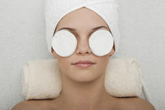 Face Cleansing. Young woman receiving face cleansing at beauty spa royalty free stock images